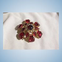 Gorgeous large Domed Glitzy Vintage Red faceted Glass Rhinestone Moonstone and Aurora Borealis rhinestone Brooch.