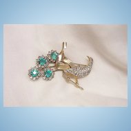 Beautiful marked Sterling Aqua and clear color rhinestone Peacock Brooch