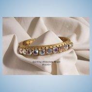 Sensational 24 sparkling Aurora Borealis Rhinestone side open Bangle Bracelet