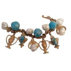 Fabulous Rare Florenza faux Turquoise bead Lion Fleur de lies spinning Fobs Charm Bracelet