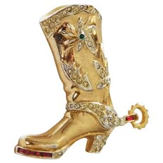 Gold plated pave & invisibly set ruby colored baguettes Cowboy Boot with Spur brooch designer Adolph Katz Coro Company 1948