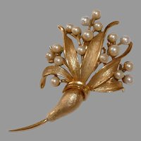 Vintage Stylized flower bouquet stems and leaves accented with faux pearl 'flowers'. Hallmarked Pegasus Coro 1950s