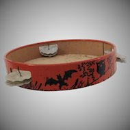 Spooky tin metal tambourine with paper face noisemaker Halloween decoration T Cohn Company 1930's
