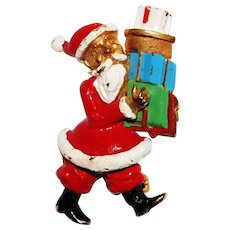 Whimsical Santa Claus brooch bearing Christmas gifts designed by Hattie Carnegie 1950's