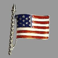 Patriotic red white and blue enameled US Flag pin by the Trifari Company
