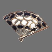 Modern Mosaics series collectible fan brooch featuring ebony black & milk white colored glass inserts designed by Alfred Philippe – 1966 Trifari