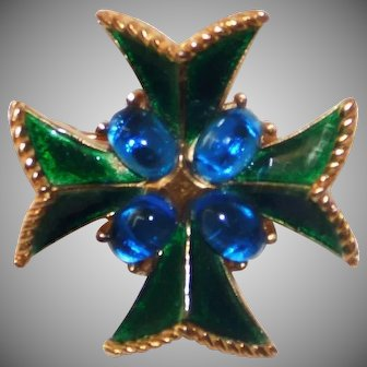 Crown Trifari enameled Maltese Cross featuring sapphire color glass cabochons 1960's