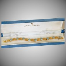 "Trifari Company ""Birthday series"" March brushed ribbon Swarovski crystal Aquamarine colored floret rhinestone Bracelet - 1950s-60s"