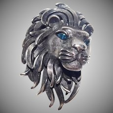 Beautiful Pewter Lion head brooch with sapphire colored eyes - Trifari Company 1960's