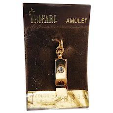 Vintage unused Amulet Whistle on original card with clear sparkly rhinestone Trifari Company 1970s