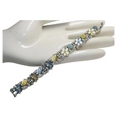 Extremely Rare hard to find Rhodium plated link Bracelet featuring Flower & Leaf shape satin glass and sparkly rhinestones - Trifari Company designer Alfred Philippe 1950s
