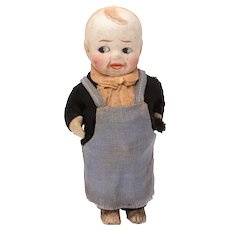 """Bisque Boy Doll, Pot Belly Butcher with Movable Arms, Frozen Legs, 4.75"""""""