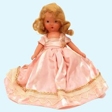 "Nancy Ann Storybook Doll Blonde Pink Dress with Lace & Gold Trim, ""Bisque"" Jointed Arms, Frozen Legs NASBD"
