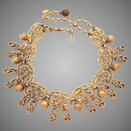 KJL Kenneth Jay Lane Russian Gold Tone Dangle Necklace, Egyptian Revival Lotus Blossoms, 1960 to 1970 Designer Necklace
