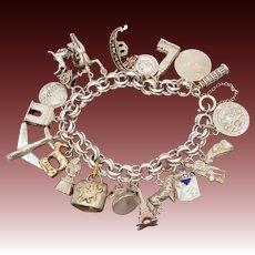 1960s European Travel Souvenir Sterling Charm Bracelet, 20 Charms, Eiffel Tower, Leaning Tower of Pisa, Spanish Bull Fighter, Gibraltar Monkey