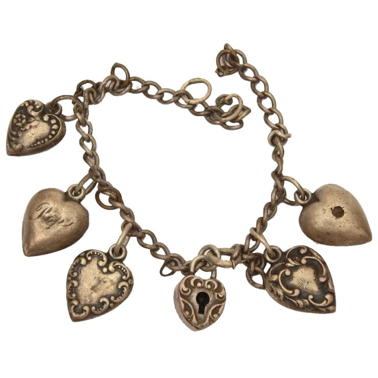 sterling puffy heart charm bracelet with 5 hearts 1 heart lock