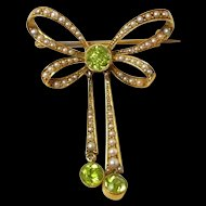 Darling Art Nouveau Bow Style Peridot and Natural Pearl Brooch c. 1890