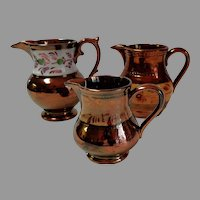 3 Copper Lustre / Luster Creamers. Jugs.   Graduated Size.  Very Old.