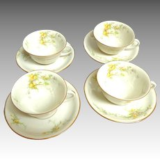 Set of 4 Limoges Cups and Saucers.  Gold Rimmed with Yellow Florals.  Mint Condition.