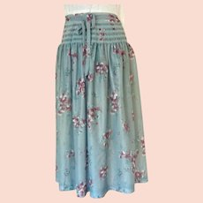 Pretty Light Polyester Skirt.  Machine Smocked Hip Area.  Blue Grey With Florals.  Size S.  Mint Condition.