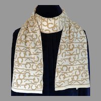 CALVIN KLEIN Logo Scarf.  Acrylic  Polyester Metallic Knit.  Double Sided.  Gold and White. Gorgeous.  As New Condition.