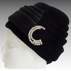 Black Satin and Velvet Cloche Hat.  Pearl and Rhinestone  Crescent Brooch Decoration.  As New Condition.