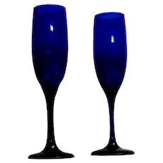 2 Cobalt Glass Champagne Flutes.
