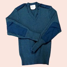 100% Wool Heavy Ribbed Man's Sweater.  Denin Blue Color with Denin Epaulettes & Elbow Patches.  Size 44.  As New Condition.