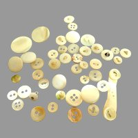 Assortment of Old Mother-of-Pearl buttons.  Various Sizes.