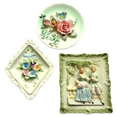 3 China Bas-Relief Plaques.  Florals and Figures.   Lovely. Charming.