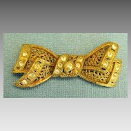 Feminine Victorian Yellow Gold Tone Bow Brooch with Paste Rhinestones