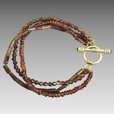 Pretty Rhodolite Garnet 3 Strand Gemstone Bracelet with Sterling Toggle