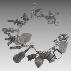 1940's Loaded Sterling Military Theme Charm Bracelet