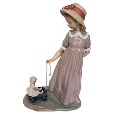 """Retired Lladro Figurine 5044 """"Girl with Toy Wagon"""" pulling Doll Mint Cond."""