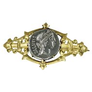 Silver Roman coin mounted in antique Victorian brooch
