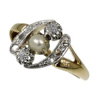 Elegant estate diamond and pearl engagement ring