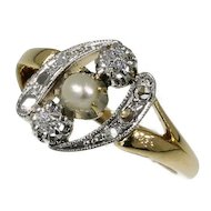Elegant estate diamond and pearl engagement ring