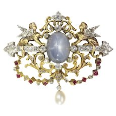 Fine 19th Century French Brooch Featuring Two Sphinxes Diamond set and One Big Star Sapphire, 1860s
