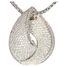 Stylish brilliant cut diamond white gold pendant and necklace (ca. 1990)