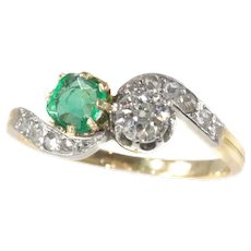 Antique Victorian Style Romantic Diamond and Emerald Toi et Moi Engagement Ring, 1910s