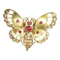 Late Victorian 18 Karat Gold Butterfly with Red Strass Stones and Half Seed Pearls, 1900s