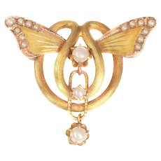 Antique 18 Karat Gold Brooch with Butterfly Wings set with Half Seed Pearls, 1900s
