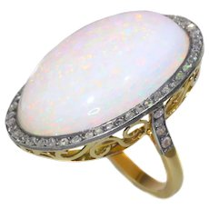 Vintage gold ring with humongous 30+ carat high quality opal and 56 rose cut diamonds