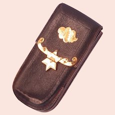 Dutch antique leather wallet with gold fittings and star motif