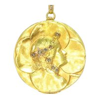 Vintage Art Nouveau lucky locket with four leaf clover and womans head set with diamonds