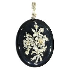 Antique Victorian onyx locket pendant with diamond loaded bouquet