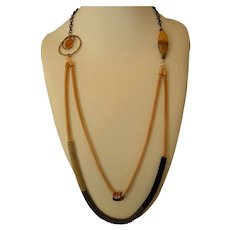 Suede-wrapped gold chain necklace with copper focal beads