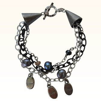 Charm Bracelet on silver and gunmetal chains with pearls