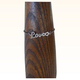 Adjustable fine chain bracelet with cz LOVE centerpiece