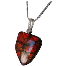 Ammolite Pendant with CZ bail and adjustable sterling silver necklace.